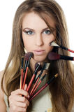The beautiful girl with brushes for a make-up Stock Photo