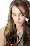 The beautiful girl with brushes for a make-up Royalty Free Stock Image