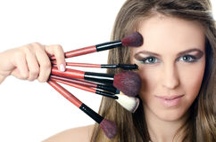 The beautiful girl with brushes for a make-up Stock Photos