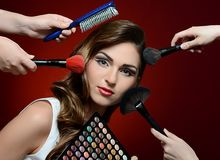 The beautiful girl with brushes make-up Stock Photography