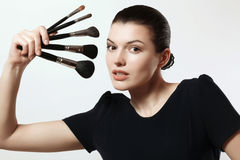 Beautiful girl with brushes for makeup. Cosmetics. Make-up artis Royalty Free Stock Photography
