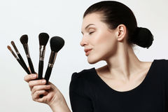 Beautiful girl with brushes for makeup. Cosmetics. Make-up artis Royalty Free Stock Photo