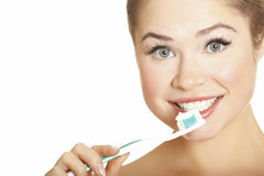Beautiful Girl Brushing her Teeth Royalty Free Stock Images