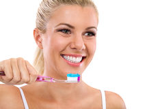 Beautiful girl brushing her teeth Stock Image