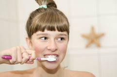 Beautiful girl brushing teeth Stock Images