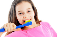 Beautiful girl brushing teeth stock image