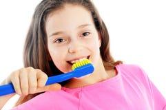 Beautiful girl brushing teeth Stock Image