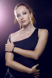 Beautiful girl brutal, with long reddish tail in a black t-shirt Stock Photo