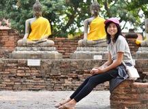 Beautiful girl and buddha at Wat Yai Chai Mongkol Temple. Ayutth Stock Photos