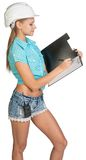 Beautiful girl builder writes with ballpoint pen Stock Photos