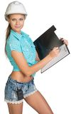 Beautiful girl builder writes with ballpoint pen Royalty Free Stock Images