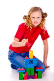 Beautiful girl building a castle with cubes Royalty Free Stock Photography