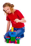 Beautiful girl building a castle with cubes Royalty Free Stock Images