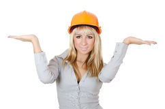 Beautiful girl in a building helmet Stock Image