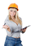 The beautiful girl in a building helmet Royalty Free Stock Photography