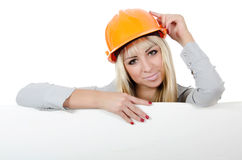 Beautiful girl in a building helmet Stock Images