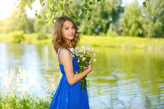 Beautiful girl with bunch of camomiles Stock Photography