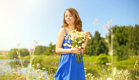 Beautiful girl with bunch of camomiles Royalty Free Stock Image