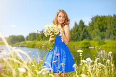 Beautiful girl with bunch of camomiles Royalty Free Stock Photography