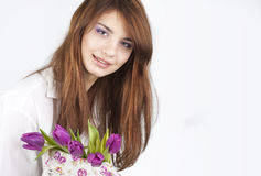 Beautiful girl with bunch of spring flowers Royalty Free Stock Photos