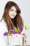 Beautiful girl with bunch of spring flowers. On white background royalty free stock image