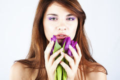 Beautiful girl with bunch of spring flowers. On white background stock photo