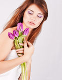 Beautiful girl with bunch of spring flowers. Isolated on white background royalty free stock photos