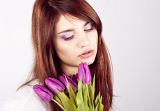 Beautiful girl with bunch of spring flowers. On white background stock photos