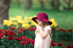Beautiful girl in a burgundy hat. Beautiful Little girl in a burgundy hat stock photos