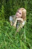 Beautiful girl bush grass. Stock Photo