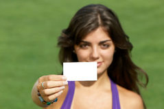 Beautiful girl with business card Royalty Free Stock Photos