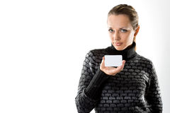 Beautiful Girl with Business Card. On gray stock images