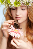 Beautiful girl and butterfly royalty free stock photography