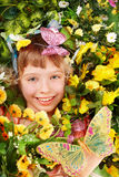 Beautiful girl with butterfly and flower. Stock Images