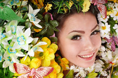 Beautiful girl with butterfly and flower. Royalty Free Stock Photography