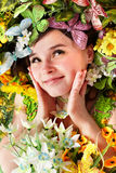 Beautiful girl with butterfly and flower on grass. royalty free stock photography