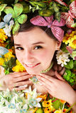 Beautiful girl with butterfly and flower on grass. Stock Photography