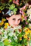 Beautiful girl with butterfly and flower on grass. Royalty Free Stock Image
