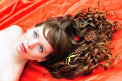 Beautiful girl with butterfly in her hair Stock Photo