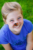 Beautiful girl with a butterfly on her nose Royalty Free Stock Photography