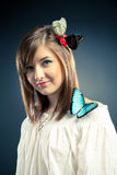 Beautiful girl and butterfly on her shoulder Royalty Free Stock Image