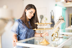 Beautiful girl buying some jewelry Royalty Free Stock Images