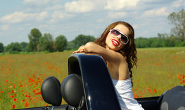 Beautiful girl in cabrio Stock Image
