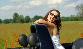 Beautiful girl in cabrio stock image