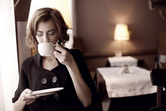Beautiful girl in the cafe. The image of a beautiful girl in a cafe Stock Photography