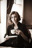 Beautiful girl in the cafe. The image of a beautiful girl in a cafe Royalty Free Stock Photos