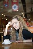 Beautiful girl  in a cafe Stock Photos