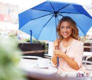 Beautiful girl in cafe Stock Photos