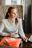 Beautiful girl in the cafe. With books Royalty Free Stock Image
