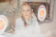 Beautiful girl in the cafe. With books Royalty Free Stock Images